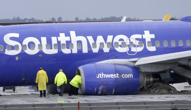A Southwest Airlines plane slid off the runway at Hollywood Burbank Airport, coming to a stop after its landing gears plowed into a barrier designed to prevent the airplane from leaving the runway Thursday, Dec. (Myung J. Chun/Los Angeles Times via AP)