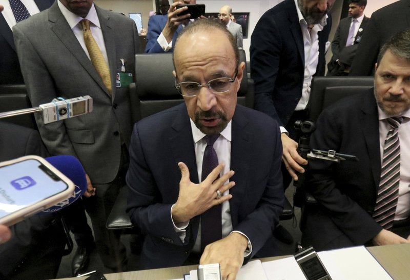 Khalid Al-Falih Minister of Energy, Industry and Mineral Resources of Saudi Arabia speaks prior to the start of a meeting of the Organization of the Petroleum Exporting Countries, OPEC, at their headquarters in Vienna, Austria, Thursday, Dec. (AP Photo/Ronald Zak)
