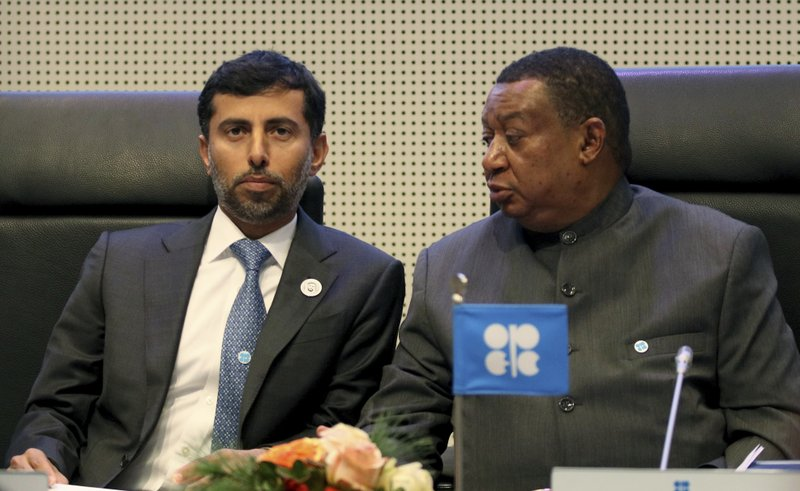 Minister of Energy of the United Arab Emirates, UAE, Suhail Mohamed Al Mazrouei talks with Mohammad Sanusi Barkindo, from left, OPEC Secretary General of Nigeria prior to the start of a meeting of the Organization of the Petroleum Exporting Countries, OPEC, at their headquarters in Vienna, Austria, Thursday, Dec. (AP Photo/Ronald Zak)
