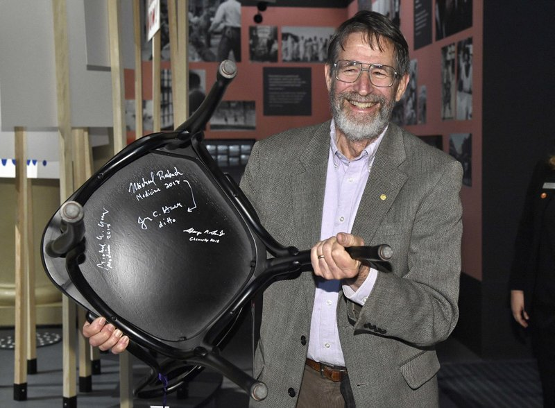 The 2018 Nobel Chemistry laureate, George P. Smith poses during the traditional Nobel Chair Signing ceremony at the Nobel Museum in Stockholm, Sweden, on Thursday Dec. (Claudio Brescian/TT via AP)