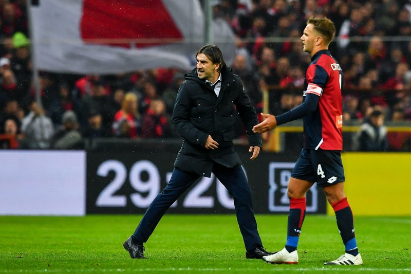 FILE - In this Nov. 25, 2018 file photo, Genoa's Croatian coach Ivan Juric, left, walks off the pitch after being sent off during the Serie A soccer match between Genoa and Sampdoria at the Luigi Ferraris Stadium in Genoa, Italy. (Simone Arveda/ANSA via AP, file)