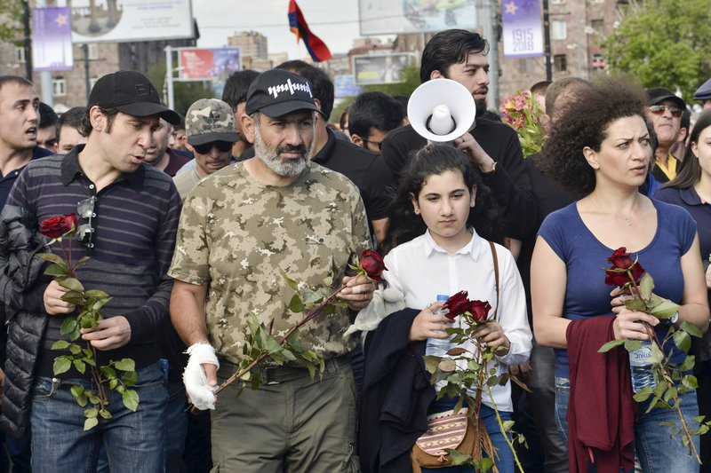 FILE - In this file photo taken on Tuesday, April 24, 2018, Armenian protest leader Nikol Pashinian, second left, leads a march to attend a memorial service at the monument to the victims of mass killings by Ottoman Turks, to commemorate the 103rd anniversary of the massacre in Yerevan, Armenia. (Karo Sahakyan/PAN Photo via AP, File)
