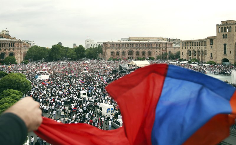 FILE - In this file photo taken on Tuesday, May 8, 2018, supporters of opposition lawmaker Nikol Pashinian gather in Republic Square in Yerevan, Armenia. (AP Photo/Thanassis Stavrakis, File)