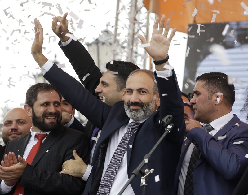FILE - In this file photo taken on Tuesday, May 8, 2018, Armenian Prime Minister Nikol Pashinian gestures as he addresses the crowd in Republic Square in Yerevan, Armenia. (AP Photo/Thanassis Stavrakis, File)