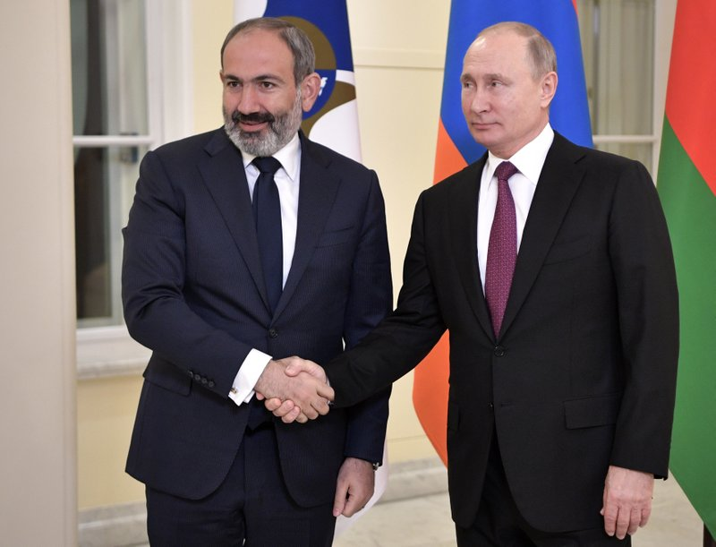 FILE In this file photo taken on Thursday, Dec. 6, 2018, Russian President Vladimir Putin, shakes hands with acting Armenian Prime Minister Nikol Pashinian at the Eurasian Economic Council in St. (Alexei Nikolsky, Sputnik, Kremlin Pool Photo via AP, File)