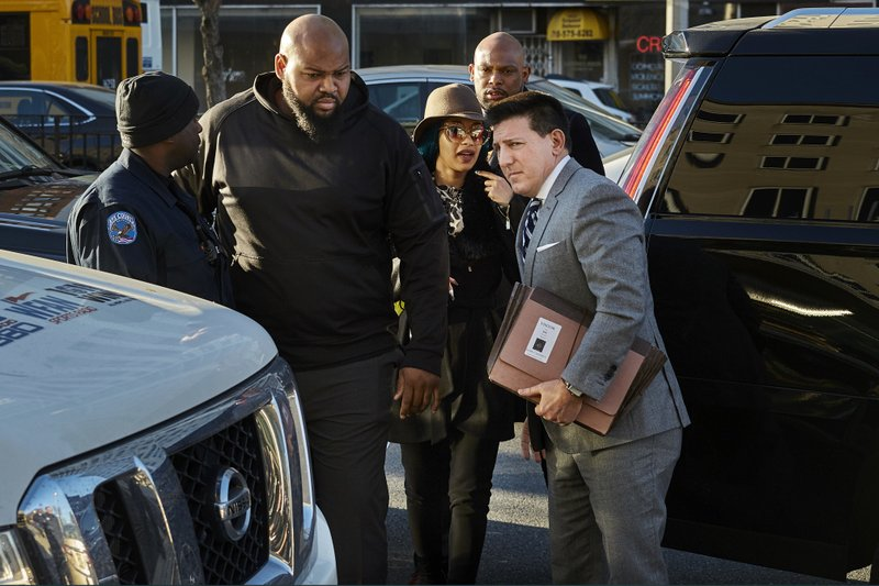 Rapper Cardi B, center right, arrives at Queens County Criminal Court, Friday, Dec. 7, 2018, in New York. (AP Photo/Andres Kudacki)
