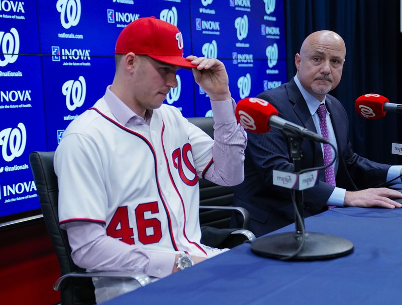 Washington Nationals President of Baseball Operations and General Manager Mike Rizzo, right, announces the signing of pitcher Patrick Corbin, left, during a news conference at Nationals Park in Washington, Friday, Dec. (AP Photo/Pablo Martinez Monsivais)
