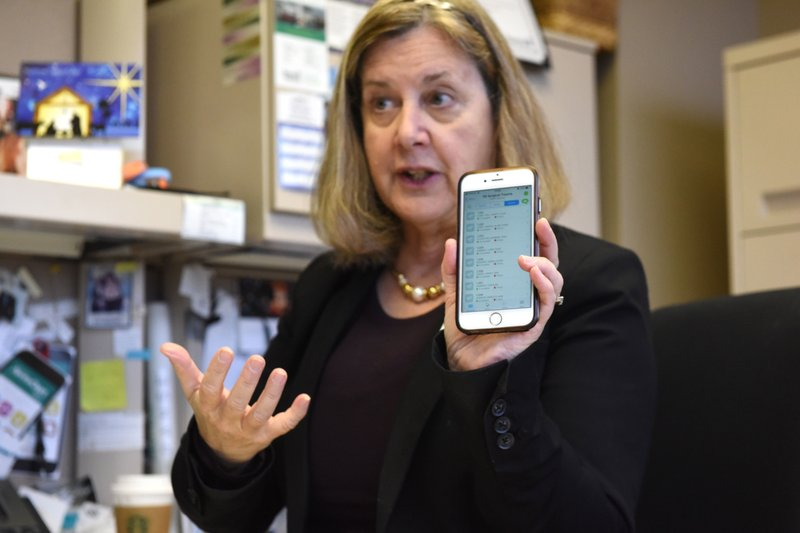 In this Nov. 29, 2018, photo, Candice Friestad, Avera Health's director of clinical informatics, holds up her phone with the app Voalte displayed in Sioux Falls, S. (Loren Townsley/The Argus Leader via AP)