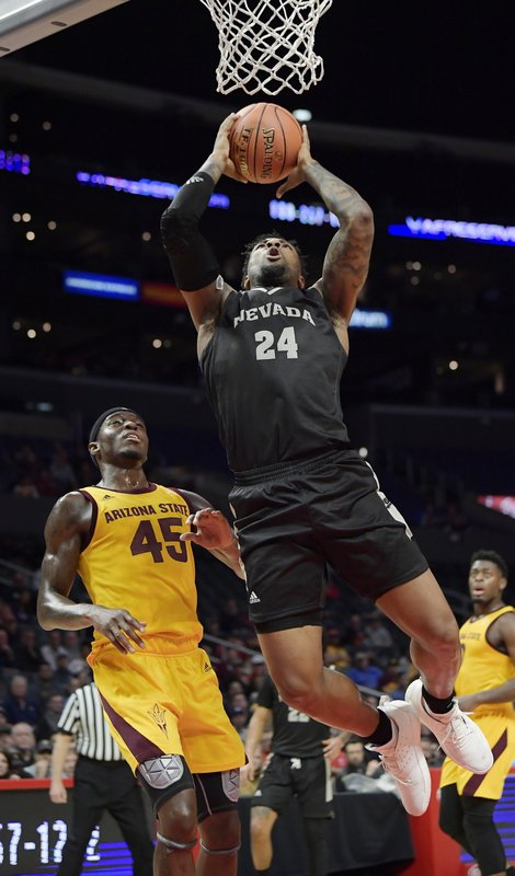 Nevada forward Jordan Caroline, right, shoots as Arizona State forward Zylan Cheatham defends during the first half of an NCAA college basketball game at the Basketball Hall of Fame Classic Friday, Dec. (AP Photo/Mark J. Terrill)