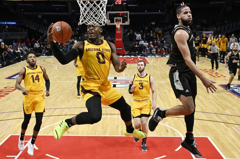 Arizona State guard Luguentz Dort, second from left, shoots as Nevada forward Caleb Martin, right, defends while forward Kimani Lawrence, left, and forward Mickey Mitchell watch during the first half of an NCAA college basketball game at the Basketball Hall of Fame Classic pm Friday, Dec. (AP Photo/Mark J. Terrill)