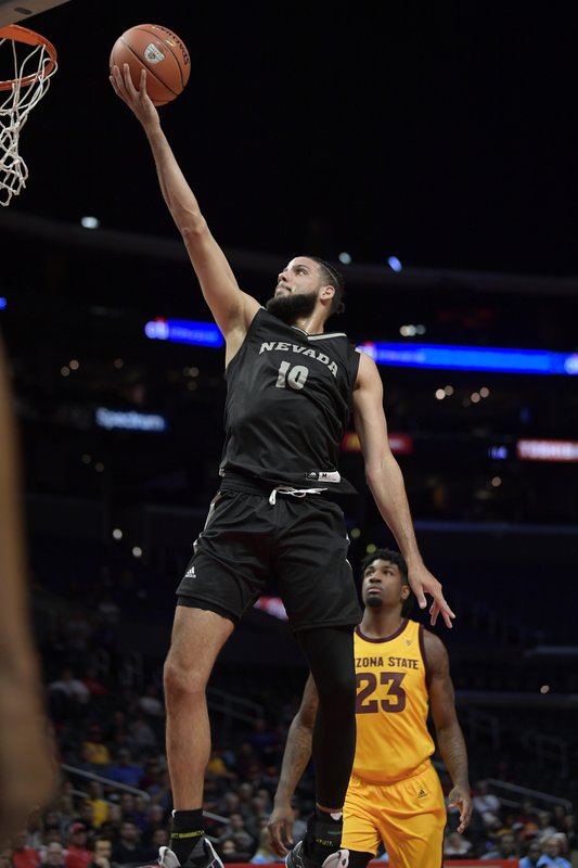 Nevada forward Caleb Martin, left, shoots as Arizona State forward Romello White watches during the first half of an NCAA college basketball game at the Basketball Hall of Fame Classic on Friday, Dec. (AP Photo/Mark J. Terrill)