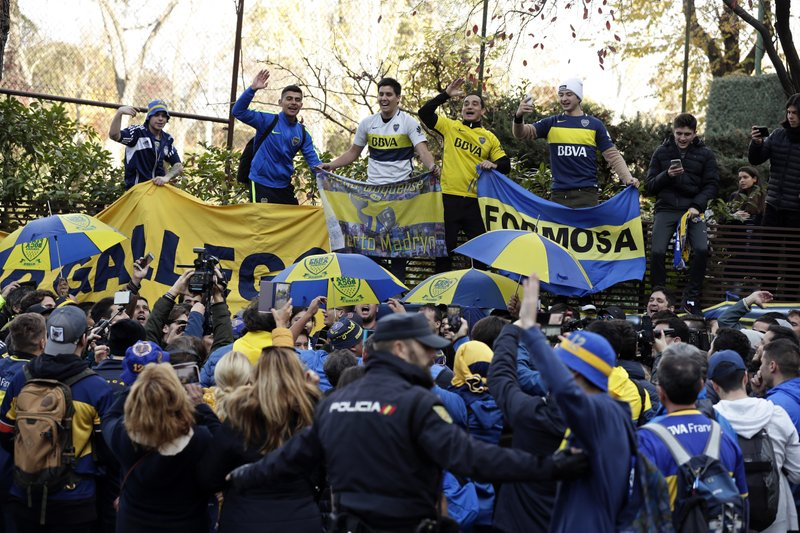 Boca Juniors supporters cheer during a gathering outside the team hotel in Madrid Saturday, Dec. 8, 2018. (AP Photo/Manu Fernandez)