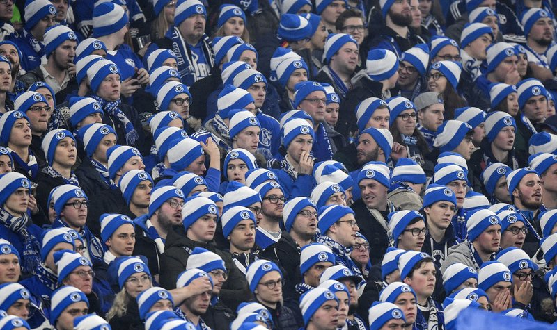 Schalke supporters wear blue and white winter hats during the German Bundesliga soccer match between FC Schalke 04 and Borussia Dortmund at the Arena in Gelsenkirchen, Germany, Saturday, Dec. (AP Photo/Martin Meissner)