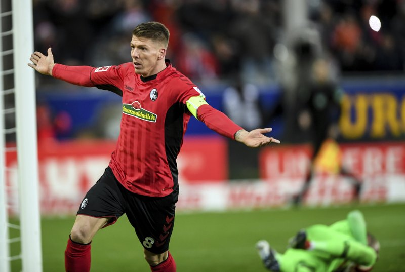 Freiburg's Mike Frantz celebrates after scoring his side's third goal during the German Bundesliga soccer match between SC Freiburg and RB Leipzig in Freiburg, southern Germany, Saturday, Dec. (Patrick Seeger/dpa via AP)