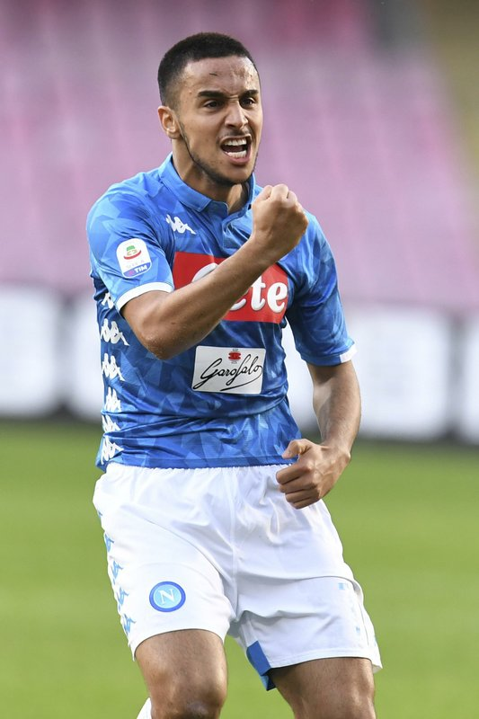 Napoli's Adam Ounas celebrates after scoring his side's second goal during the Serie A soccer match between Napoli and Frosinone, at the San Paolo stadium in Naples, Italy, Saturday, Dec. (Ciro Fusco /ANSA via AP)