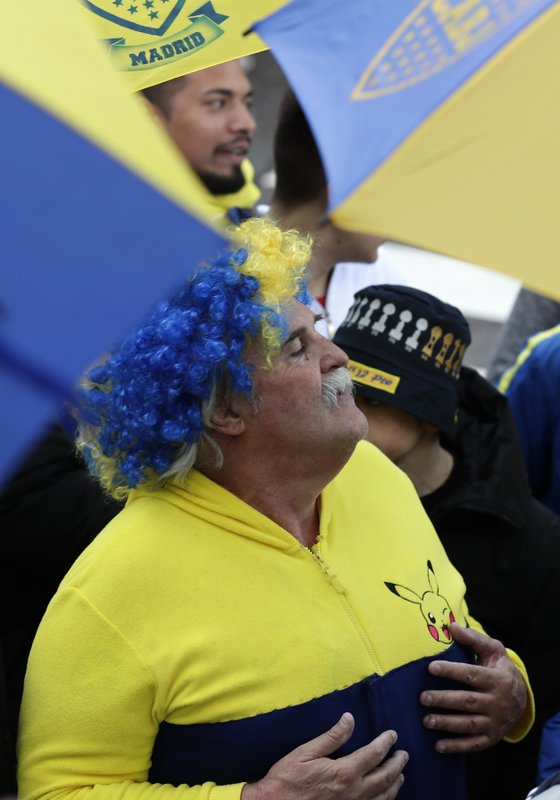 Boca Juniors supporters gather outside the team hotel in Madrid Saturday, Dec. 8, 2018. The Copa Libertadores Final between River Plate and Boca Juniors will be played on Dec. (AP Photo/Manu Fernandez)