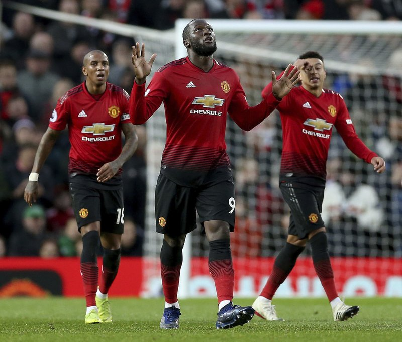 Manchester United's Romelu Lukaku, center, celebrates scoring his side's third goal of the game during their English Premier League soccer match against Fulham at Old Trafford, Manchester, England, Saturday, Dec. (Barrington Coombs/PA via AP)