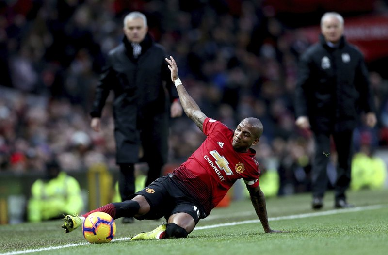 Manchester United's Ashley Young controls the ball, during the English Premier League soccer match between Manchester United and Fulham, at Old Trafford, Manchester, England, Saturday, Dec. (Barrington Coombs/PA via AP)