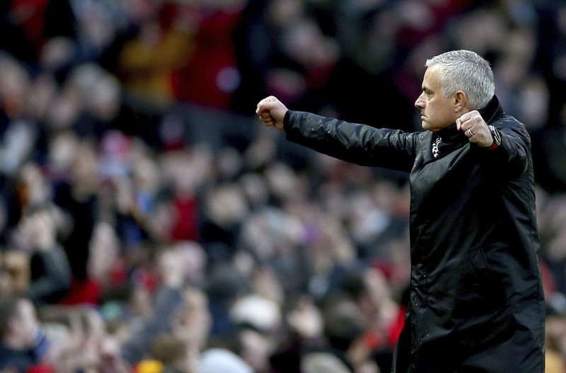 Manchester United manager Jose Mourinho celebrates after Juan Mata scores his side's second goal of the game during their English Premier League soccer match against Fulham at Old Trafford, Manchester, England, Saturday, Dec. (Barrington Coombs/PA via AP)