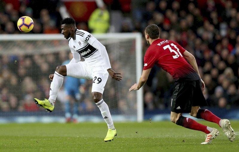 Fulham's Andre-Frank Zambo Anguissa, left, and Manchester United's Nemanja Matic in action during their English Premier League soccer match at Old Trafford, Manchester, England, Saturday, Dec. (Barrington Coombs/PA via AP)