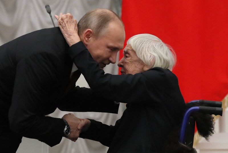 FILE  - In this file photo taken on Monday, Dec. 18, 2017, Russian President Vladimir Putin, left, congratulates the Moscow Helsinki Group Chair and human rights activist Lyudmila Alexeyeva, during a ceremony to present the 2017 State Awards for Outstanding Achievements in Human Rights and and Charity Work at the Kremlin in Moscow, Russia. (Yuri Kochetkov/Pool Photo via AP, File)