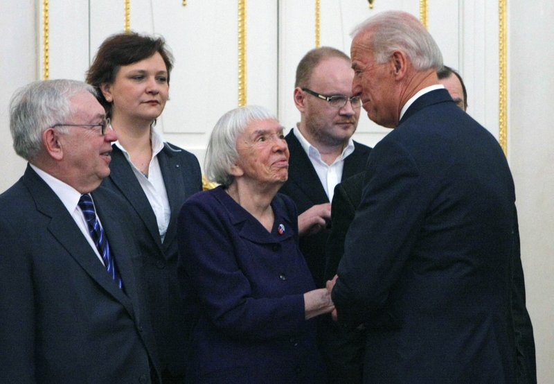 FILE In this file photo taken on Thursday, March 10, 2011, Vice President of the United States Joe Biden, right, speaks to Russian human right's activist Lyudmila Alexeyeva, second right, as he meets with Russian Civil Society leaders in Moscow, Russia. (AP Photo/Alexander Zemlianichenko)