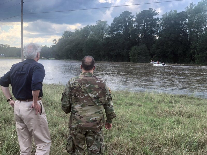 FILE - In this South Carolina Gov. Henry McMaster, left, and U.S. Army Lt. Col. John McElveen look on as a Swift Water squad from Louisiana bring two stranded motorists to safety in Chesterfield County, S. (AP Photo/Meg Kinnard, File)