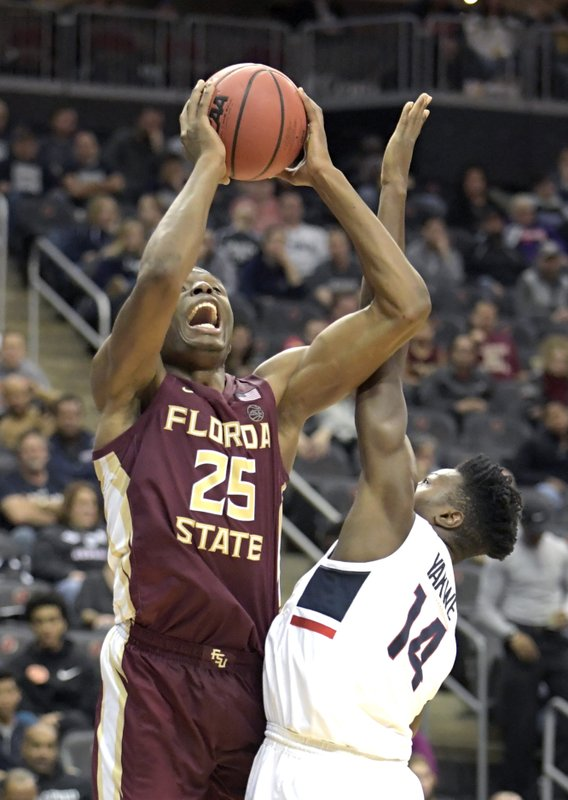 Florida State forward Mfiondu Kabengele (25) attempts a shot over Connecticut forward Kassoum Yakwe (14) during the first half of an NCAA college basketball game in the Never Forget Tribute Classic Saturday, Dec. (AP Photo/Bill Kostroun)