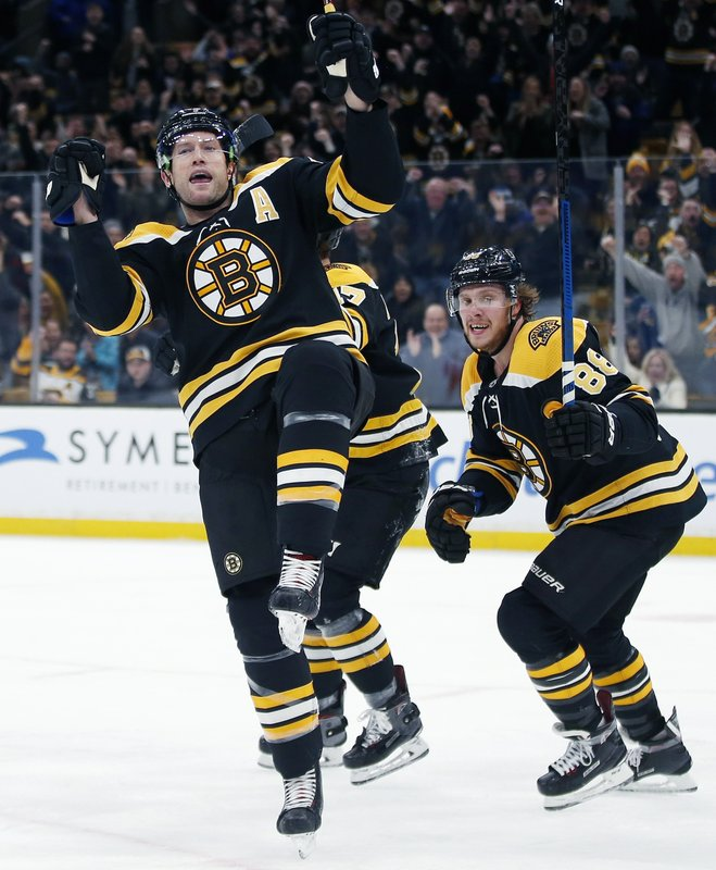 Boston Bruins' David Backes, left, celebrates his goal in front of teammate David Pastrnak (88) during the second period of an NHL hockey game against the Toronto Maple Leafs in Boston, Saturday, Dec. (AP Photo/Michael Dwyer)
