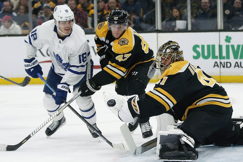 Toronto Maple Leafs' Andreas Johnsson (18) looks for the rebound after taking a shot on Boston Bruins' Jaroslav Halak (41) as Torey Krug (47) defends during the first period of an NHL hockey game in Boston, Saturday, Dec. (AP Photo/Michael Dwyer)