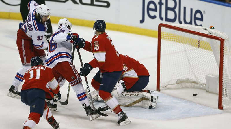New York Rangers center Mika Zibanejad (93) shoots and scores against Florida Panthers goaltender Roberto Luongo (1) during the first period of an NHL hockey game, Saturday, Dec. (AP Photo/Brynn Anderson)
