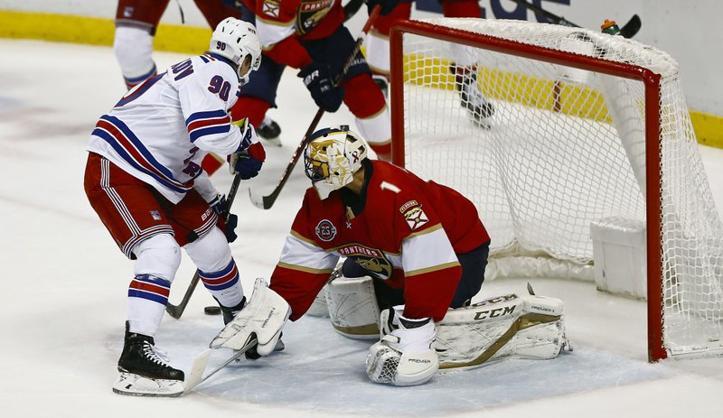 New York Rangers center Vladislav Namestnikov (90) scores against Florida Panthers goaltender Roberto Luongo (1) during the first period of an NHL hockey game Saturday, Dec. (AP Photo/Brynn Anderson)