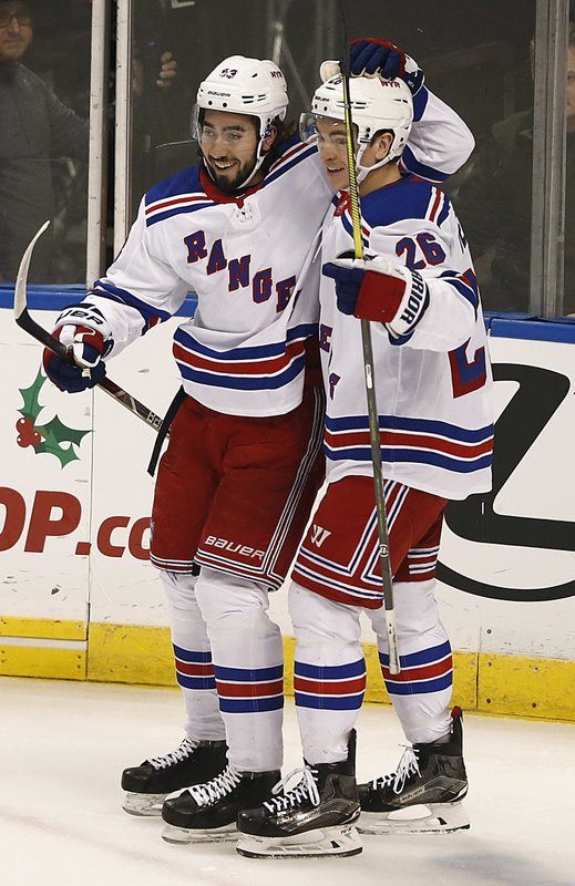 New York Rangers center Mika Zibanejad, left, and New York Rangers left wing Jimmy Vesey, right, celebrate after Zibanejad scored during the first period of an NHL hockey game against the Florida Panthers on Saturday, Dec. (AP Photo/Brynn Anderson)