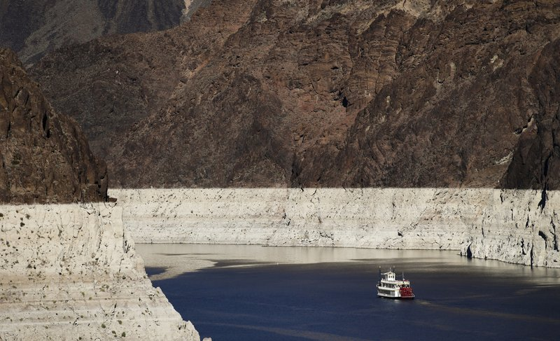 FILE - In this Oct. 14, 2015, file photo, a riverboat glides through Lake Mead on the Colorado River at Hoover Dam near Boulder City, Nev. (AP Photo/Jae C. Hong, File)