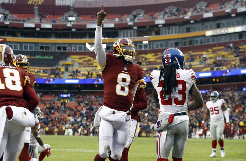 Washington Redskins quarterback Josh Johnson (8) celebrates his touchdown during the second half of an NFL football game against the New York Giants, Sunday, Dec. (AP Photo/Patrick Semansky)