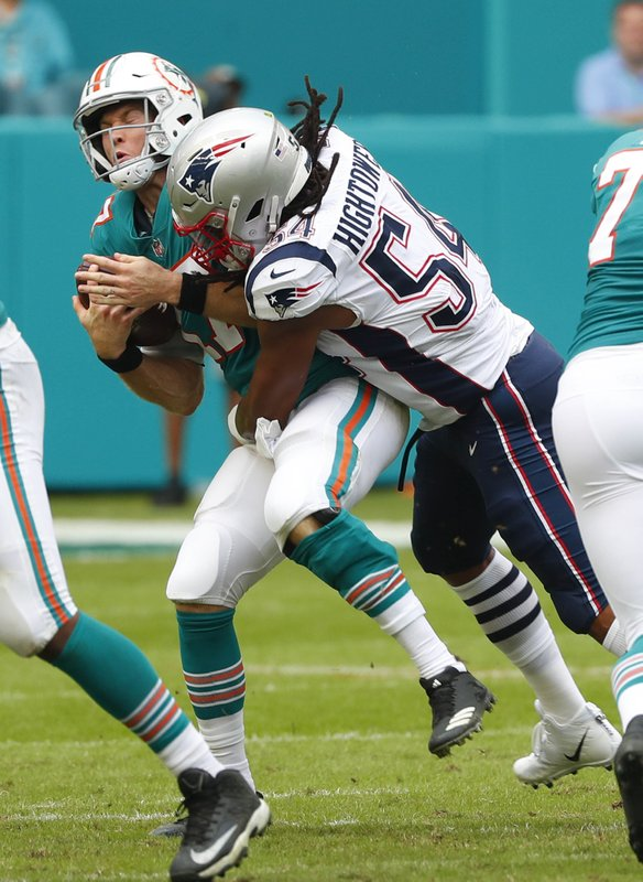 New England Patriots outside linebacker Dont'a Hightower (54) tackles Miami Dolphins quarterback Ryan Tannehill (17), during the first half of an NFL football game, Sunday, Dec. (AP Photo/Wilfredo Lee)