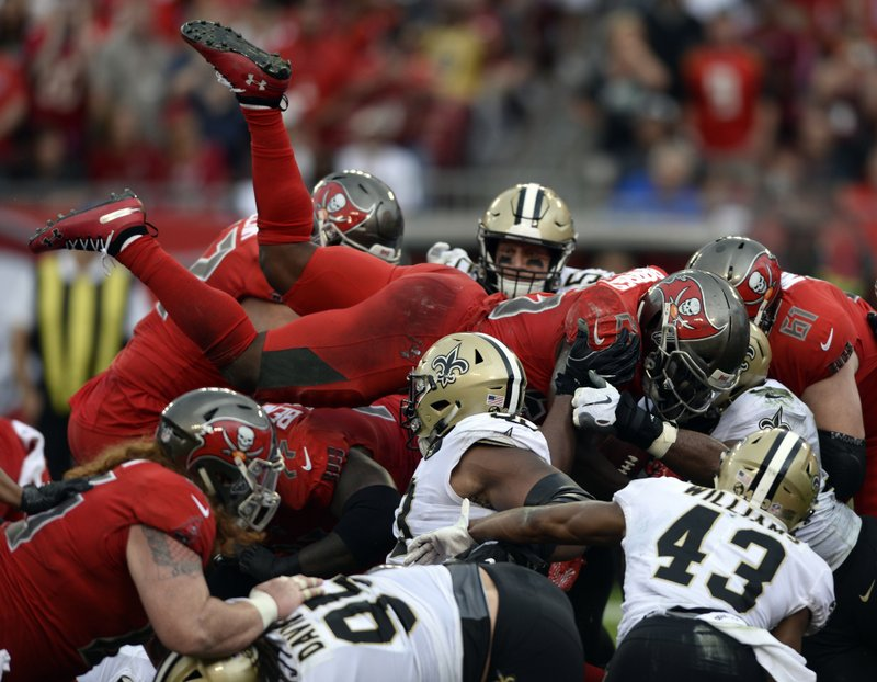 Tampa Bay Buccaneers running back Peyton Barber (25) attempts to dive into the endzone against the New Orleans Saints during the first half of an NFL football game Sunday, Dec. (AP Photo/Jason Behnken)