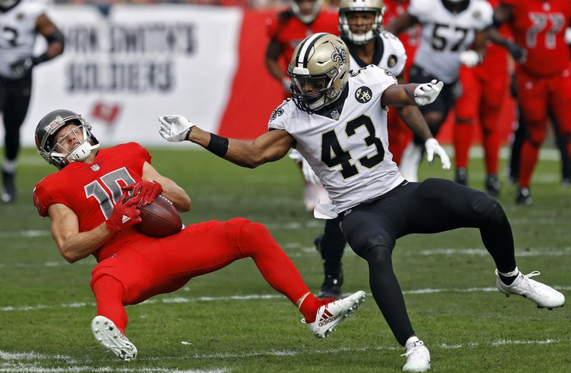 New Orleans Saints free safety Marcus Williams (43) levels Tampa Bay Buccaneers wide receiver Adam Humphries (10) after a reception during the first half of an NFL football game Sunday, Dec. (AP Photo/Mark LoMoglio)