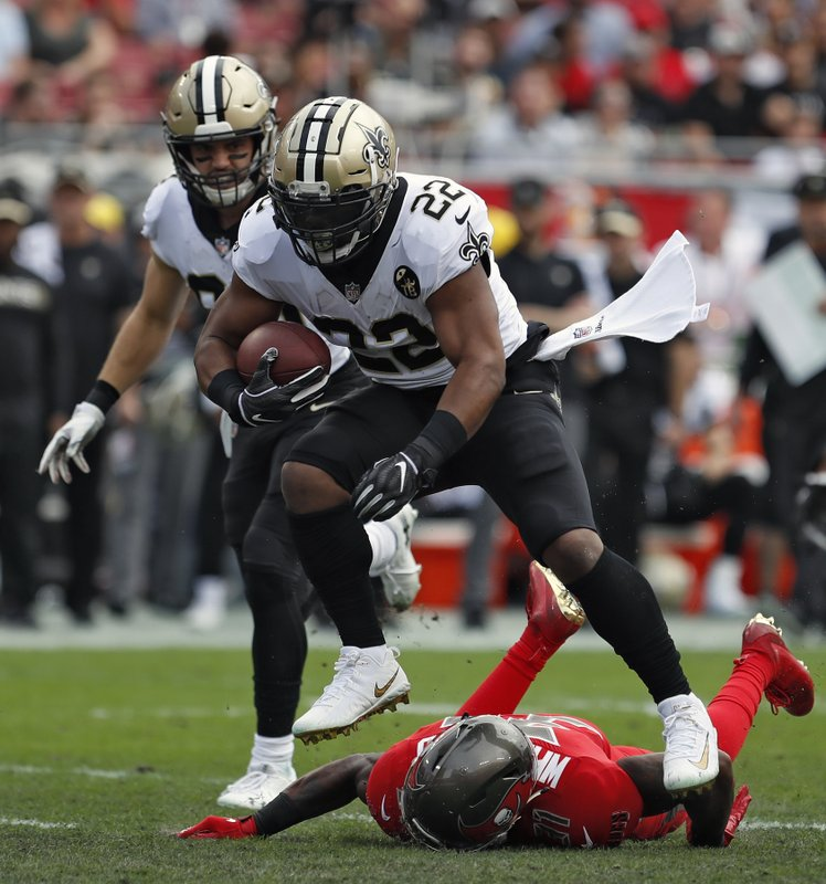 New Orleans Saints running back Mark Ingram (22) leaps over Tampa Bay Buccaneers free safety Jordan Whitehead (31) on a run during the first half of an NFL football game Sunday, Dec. (AP Photo/Mark LoMoglio)