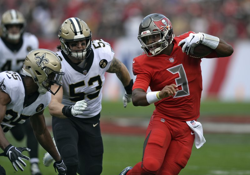 Tampa Bay Buccaneers quarterback Jameis Winston (3) tries to elude New Orleans Saints cornerback Eli Apple (25) and outside linebacker A. (53) on a run during the first half of an NFL football game Sunday, Dec. 9, 2018, in Tampa, Fla. (AP Photo/Jason Behnken)