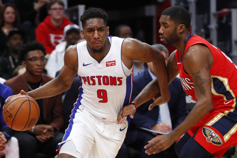 Detroit Pistons guard Langston Galloway (9) drives against New Orleans Pelicans guard E'Twaun Moore (55) in the first half of an NBA basketball game in Detroit, Sunday, Dec. (AP Photo/Paul Sancya)