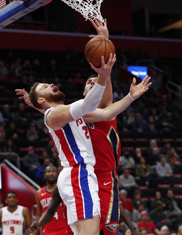 Detroit Pistons forward Blake Griffin (23) drives on New Orleans Pelicans forward Nikola Mirotic (3) in the first half of an NBA basketball game in Detroit, Sunday, Dec. (AP Photo/Paul Sancya)