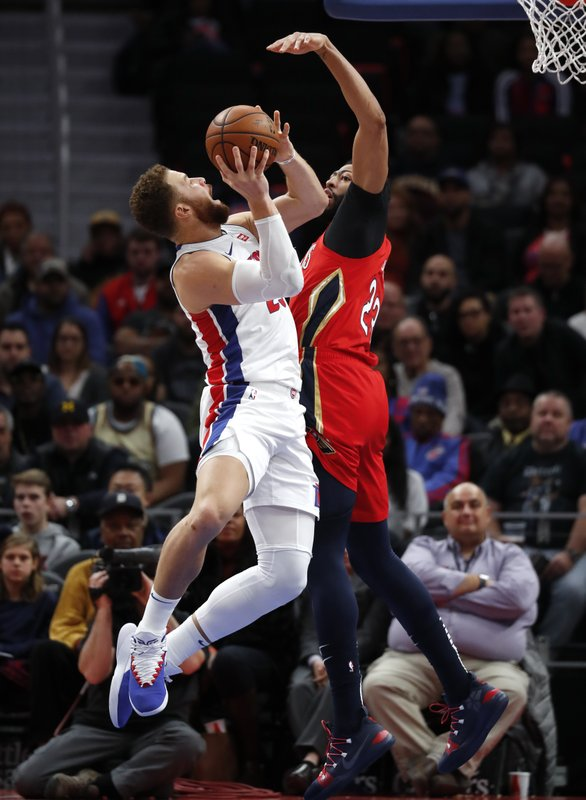 Detroit Pistons forward Blake Griffin (23) drives on New Orleans Pelicans forward Anthony Davis (23) in the second half of an NBA basketball game in Detroit, Sunday, Dec. (AP Photo/Paul Sancya)
