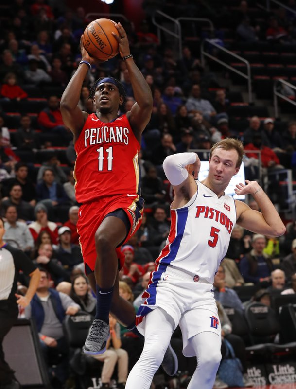 New Orleans Pelicans guard Jrue Holiday (11) drives against Detroit Pistons guard Luke Kennard (5) in the second half of an NBA basketball game in Detroit, Sunday, Dec. (AP Photo/Paul Sancya)