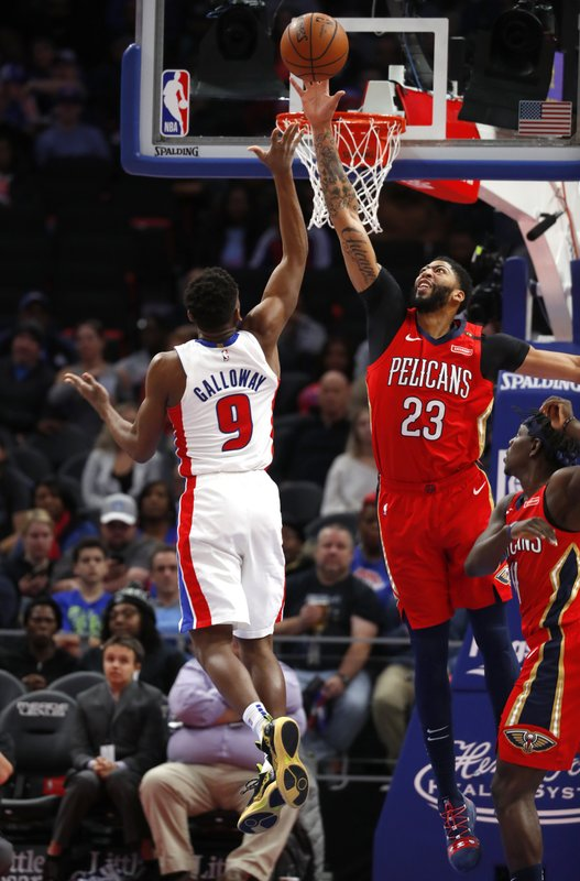 New Orleans Pelicans forward Anthony Davis (23) blocks a shot byDetroit Pistons guard Langston Galloway (9) in the second half of an NBA basketball game in Detroit, Sunday, Dec. (AP Photo/Paul Sancya)