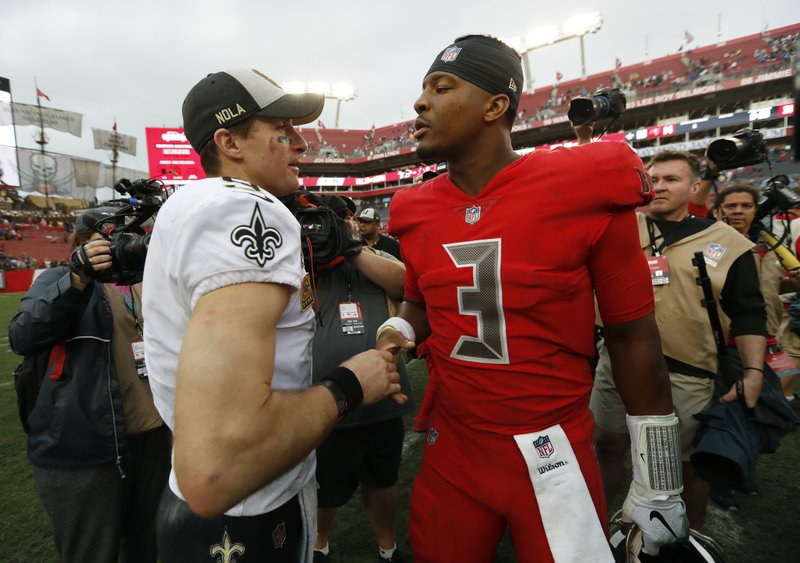 New Orleans Saints quarterback Drew Brees (9) shakes hands with Tampa Bay Buccaneers quarterback Jameis Winston (3) after an NFL football game Sunday, Dec. (AP Photo/Mark LoMoglio)