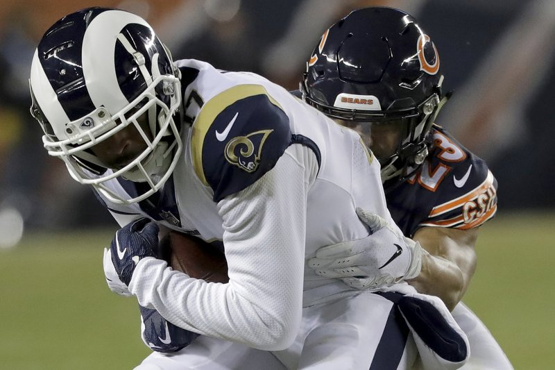 Chicago Bears cornerback Kyle Fuller (23) tackles Los Angeles Rams wide receiver Robert Woods (17) during the first half of an NFL football game Sunday, Dec. (AP Photo/Nam Y. Huh)