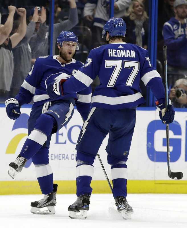 Tampa Bay Lightning center Steven Stamkos (91) celebrates his goal against the New York Rangers with defenseman Victor Hedman (77) during the first period of an NHL hockey game Monday, Dec. (AP Photo/Chris O'Meara)