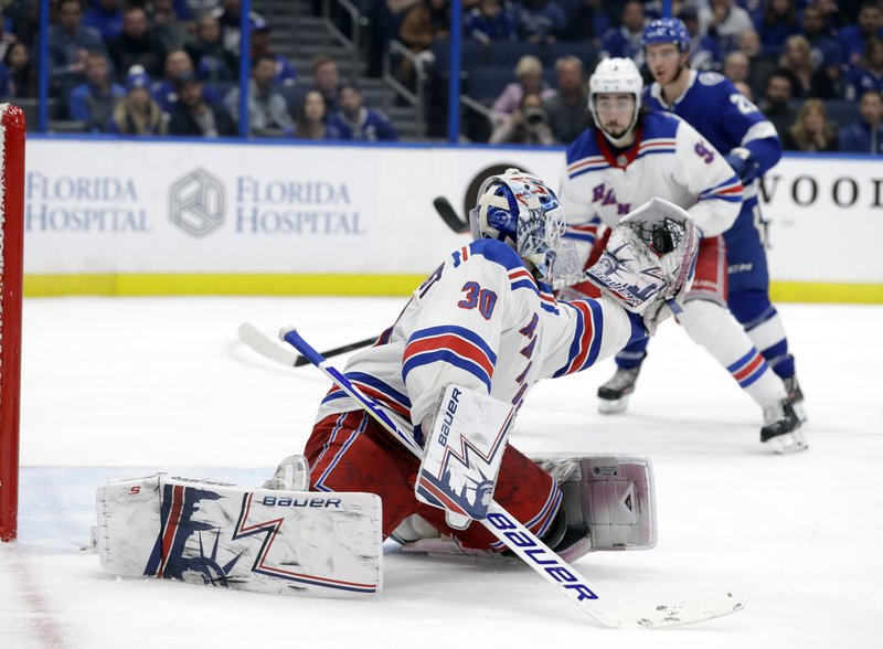 New York Rangers goaltender Henrik Lundqvist (30) makes a glove save on a shot by the Tampa Bay Lightning during the second period of an NHL hockey game Monday, Dec. (AP Photo/Chris O'Meara)