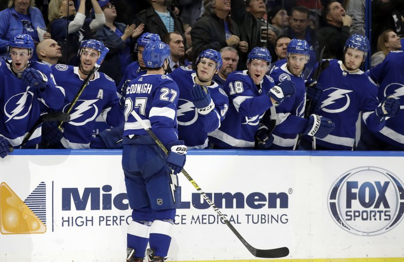 Tampa Bay Lightning defenseman Ryan McDonagh (27) celebrates with the bench after his goal against the New York Rangers during the second period of an NHL hockey game Monday, Dec. (AP Photo/Chris O'Meara)